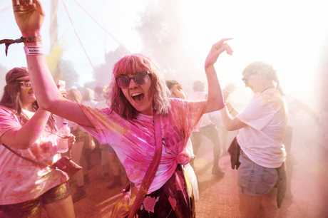 Splendour festival goers have fun at the Contiki Colour Party which turned Spelndour into a suburb of Dehli. Photo Marc Stapelberg / The Northern Star