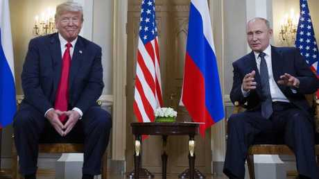 Mr Putin and Mr Trump chat at the Presidential Palace in Helsinki, Finland. Picture: AP Photo/Pablo Martinez Monsivais