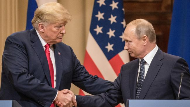 Trump and Putin go in for a handshake. Picture: Chris McGrath/Getty Images