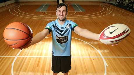 Check out Bogut's wingspan. Note the footy in his left hand - is he planning a Bolt-inspired cross-code career switch? Picture: David Caird