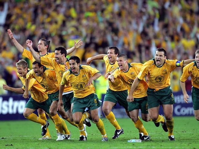 Captain Mark Viduka (7), Tim Cahill (4) and Harry Kewell (back left) celebrate Australia's qualifying win over Uruguay.