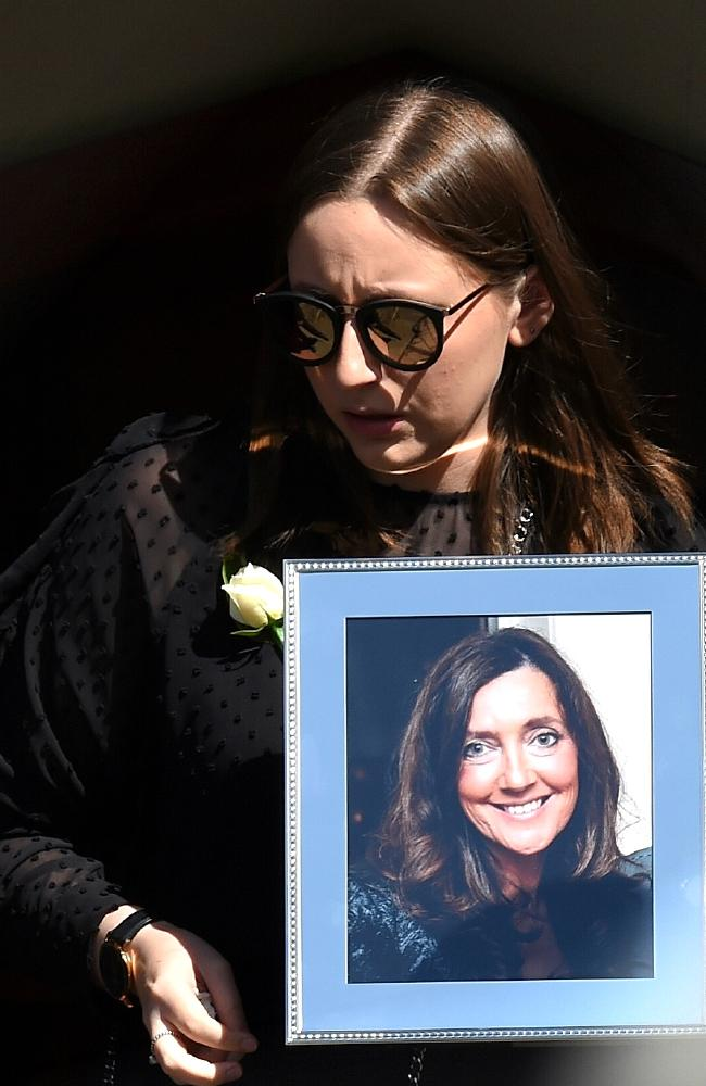Sarah Ristevski leaves an Essendon church with a photo of her mum, Karen. Picture: Nicole Garmston