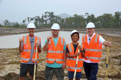 Surfing greats Barton Lynch and Mark Occhilupo and his son Jay join Surf Lakes CEO Aaron Trevis on a site inspection of works at the wave pool site near Rockhampton last year.