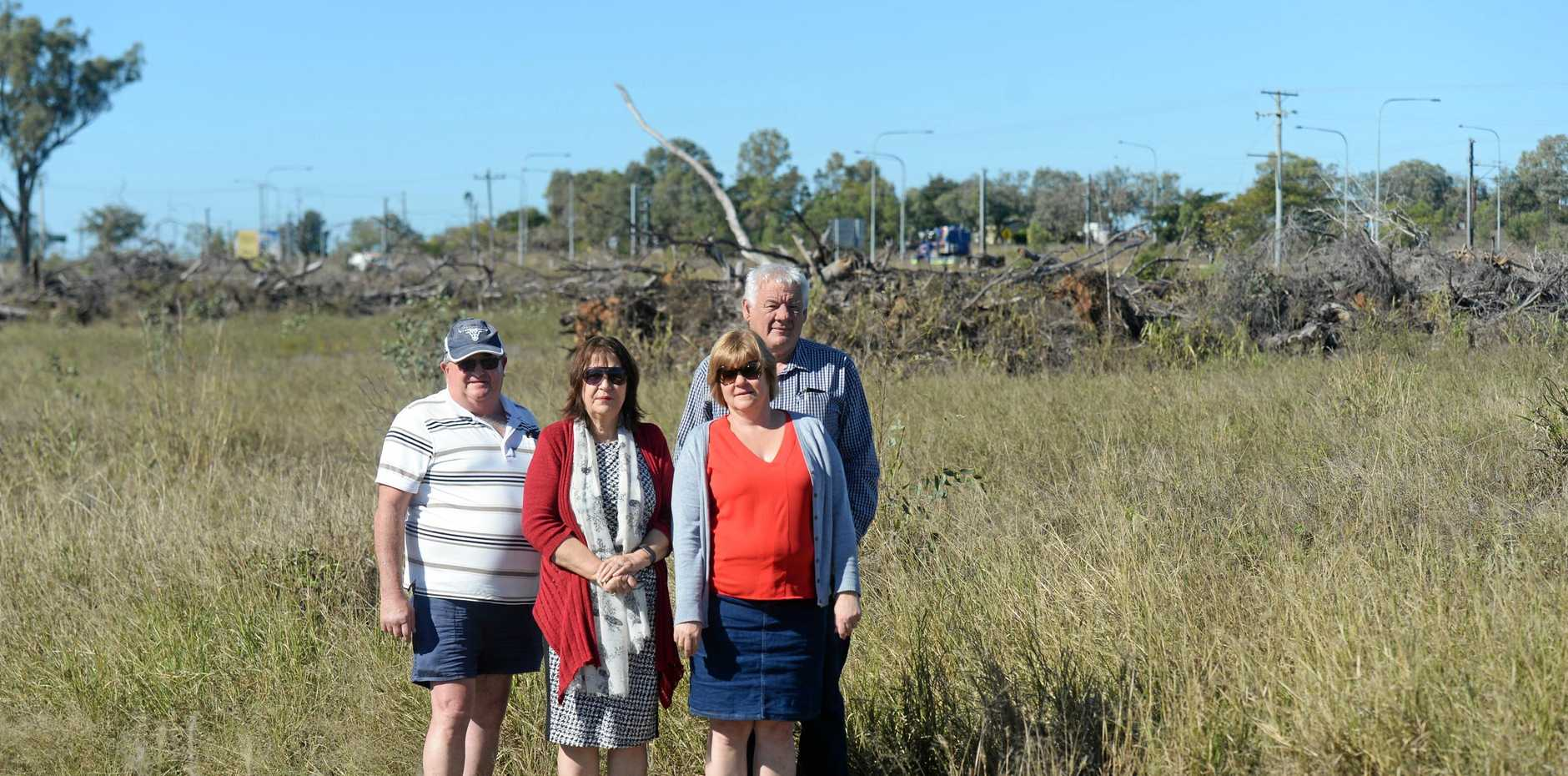Errol and Linda Rheinberger, Louise Ward, and Paul Kowalski from Gracemere are opposed to a 24/7 service station and truck stop being built on this vacant block of land near the Gracemere Overpass. They are concerned about flooding (inset shows water over the site in 2013) and heavy trucks turning.