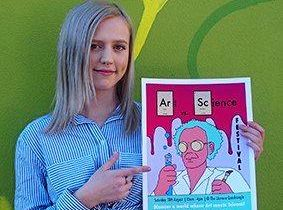 Southern Cross University digital media and communications student Charly Crossing with her winning Arts Vs Science Festival 2018 poster design.