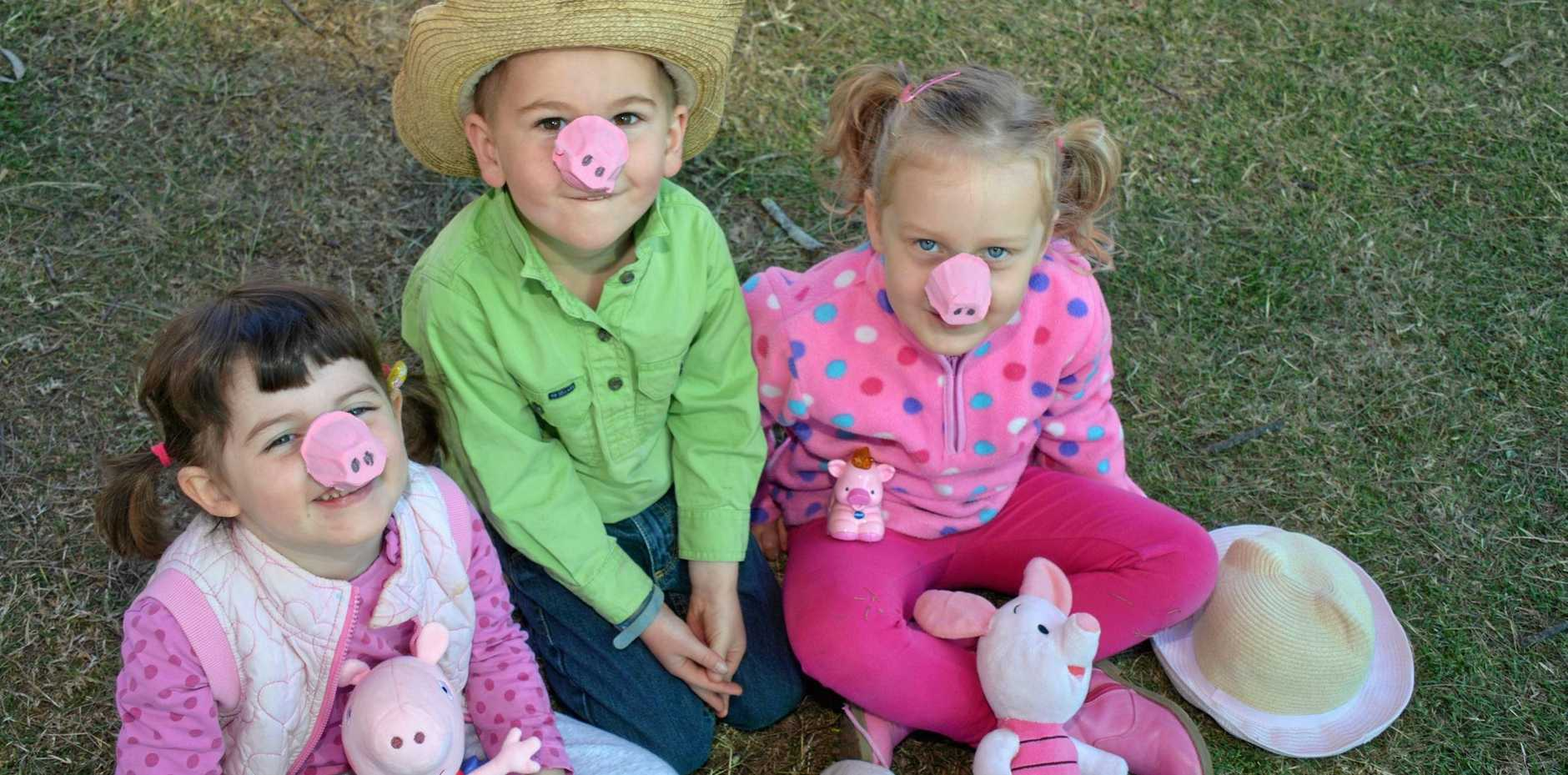 OINK: Eloise Mungall, Josh Lamping and Matilda Phillips get ready for Baconfest's Little Piggies in the Park.