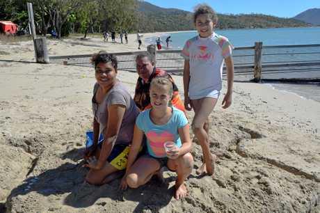 Debra Pappberll, Helen Watts Sasha Radley and Saheirea Corowa-Watts with their sand-turtle at Dingo Beach.