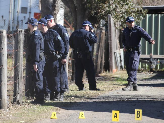 Police at the Bringelly property after the alleged home invasion on Tuesday. Picture: John Grainger
