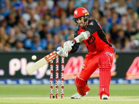 Tom Cooper smashes a four for the Melbourne Renegades. Picture: Getty