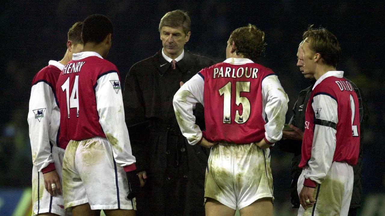 Arsene Wenger with some of his players in 2000.
