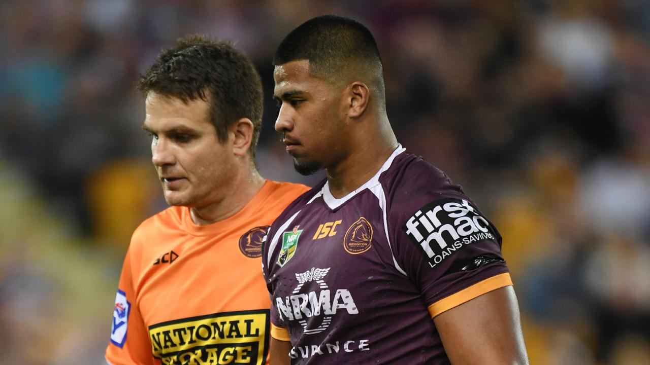 Payne Haas of the Broncos (right) is taken off the field injured during the Round 9 NRL match. (AAP Image/Dan Peled)