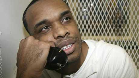 In this June 13, 2018, photo, death-row inmate Christopher Young holds a phone to his ear during an interview outside death row. Picture: AP/Mike Graczyk