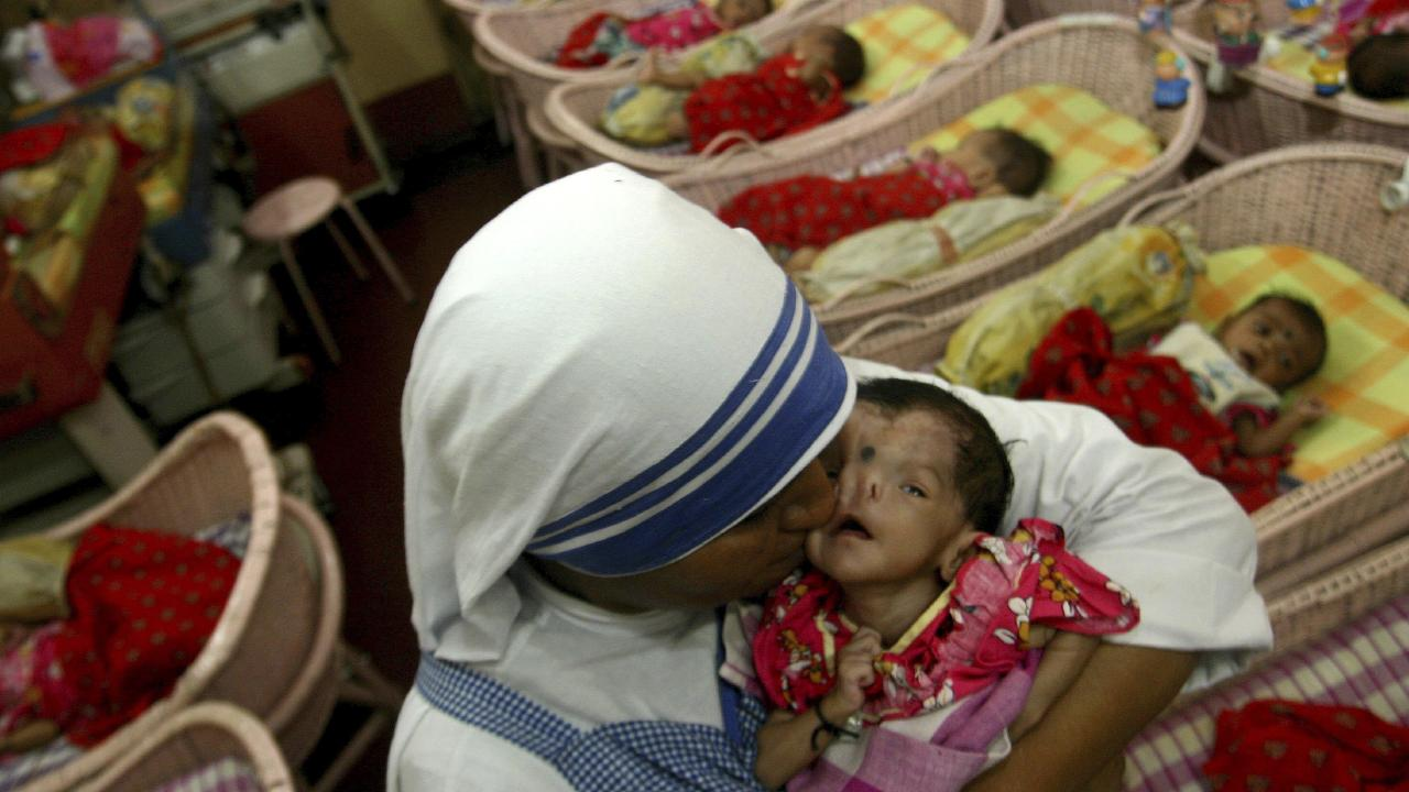 A nun of Mother Teresa's Missionaries of Charity kisses a handicapped infant A nun and a worker at one of its shelters for unwed mothers have been arrested for allegedly selling a baby. Picture: AP