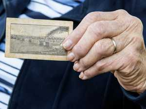 joan Cootes shows off her original train ticket from