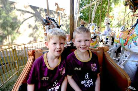 POPULAR RIDE: Noah Bevelander, 7, and brother Sam, 9, test out the Royal Double Decker Carousel at the Rockhampton River Festival.
