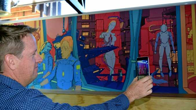 APP MAGIC: Peregian Digital Hub director Chris Boden waves his smart phone to make this mural