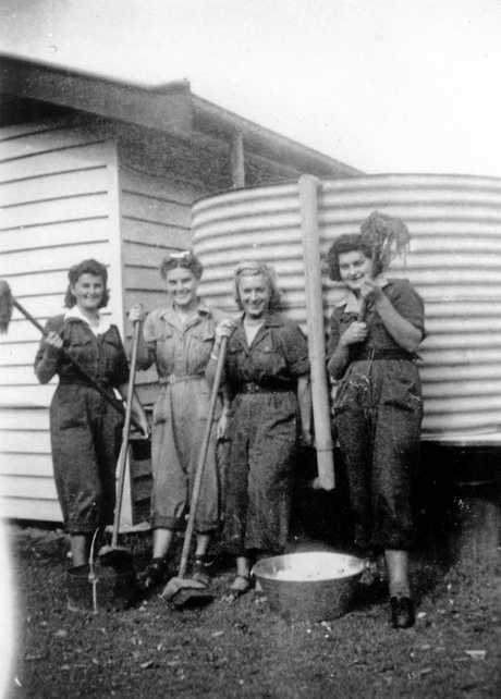 Cleaning duties, outside the WRANS cottage in Memorial Lane, Caloundra. L-R: Babs, Betty, Doris and Francis, ca 1945.
