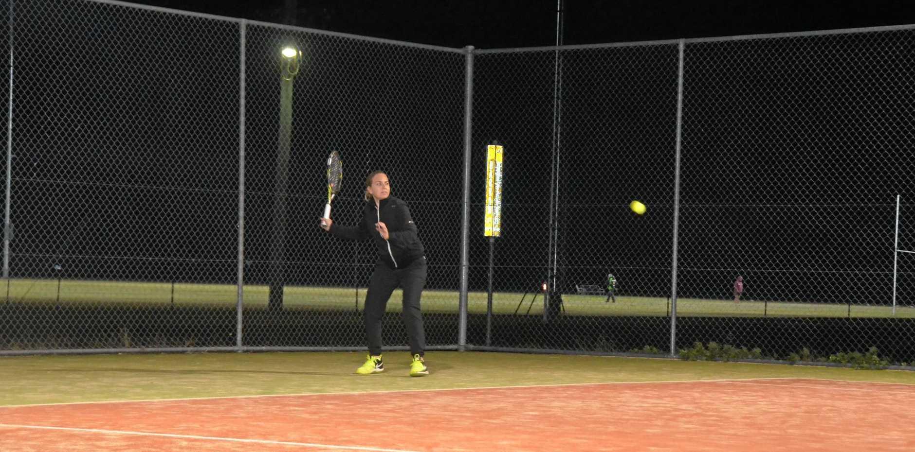 HITTING IT OFF: Trudi Allan's first time playing tennis in Gayndah.
