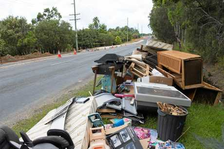 Household waste left on the kerbside at Sandy Beach.