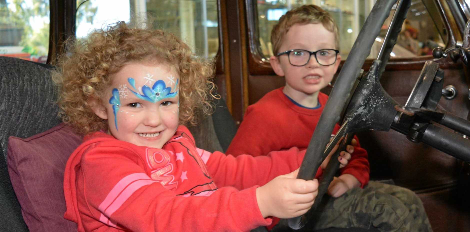 LADY DRIVER: Ruby Philip drives while her brother Cooper Philip rides shot gun at the Queensland Transport Museum Open Day.