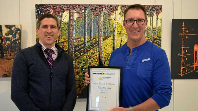ACHIEVEMENT: Emerald Art Gallery treasurer Andy Freeman with Michael Gagnepain, who won the Acquisitive prize for his work  Serenity .