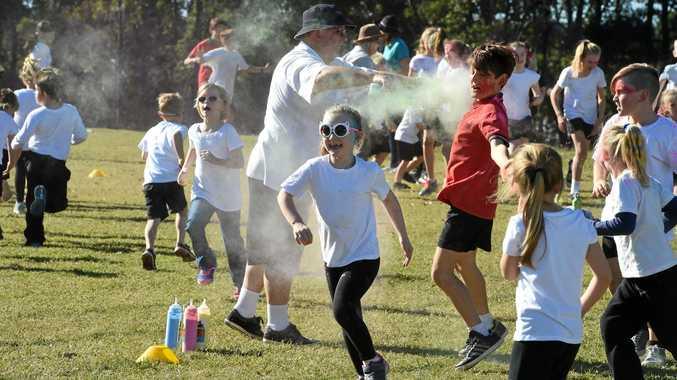 COLOUR FUN RUN: Amelia Neilsen runs through the colour at Tinana State School.