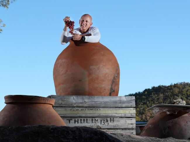Glen Robert inside one of the terracotta pots that he buries and uses for wine making. Picture: Liam Kidston