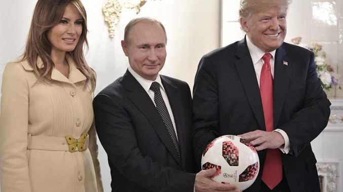 Russian and US Presidents Vladimir Putin and Donald Trump with First Lady Melania Trump following their meeting at the Presidential Palace in Helsinki on Monday. Picture: AP