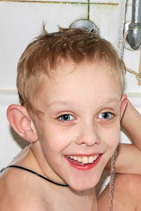 Redbank Plains boy Bryn, 8, and his brother Rohan both inherited the Fragile X gene.