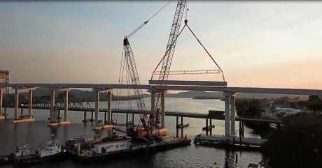 The final girder is lifted into place on the new Harwood Bridge.