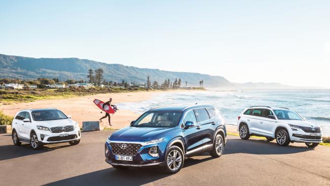 Kia Sorento, left, Hyundai Santa Fe and Skoda Kodiaq. Pictures: Thomas Wielecki