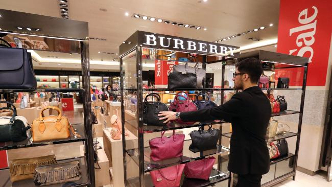An employee arranges a display of women's handbags in the Burberry Group in Moscow, Russia. Picture: Andrey Rudakov/Bloomberg.