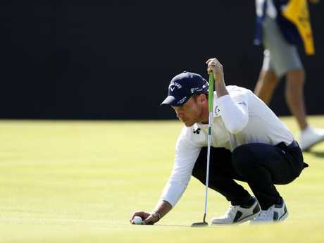 Danny Willett of England lines up a putt on the 13th green. Picture: AP