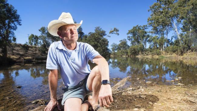 Mundubbera farmer Mark Postle sits where the Boyne River runs through his property at Glenrae North. He fears the worst for Mundubbera farmers and the people in the town as their water supply is set to be cut off. Picture: Lachie Millard