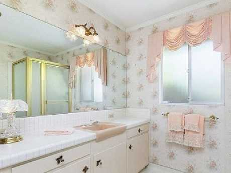 The bathroom of the famous house feature's 70s wallpaper. Picture: Zillow