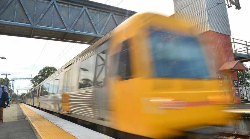 A train arrives at Landsborough station.