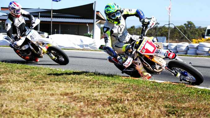 SUPERMOTO: Andy McLeish leads Kayden Downing into turn one during the Supermoto Pro final on Saturday.