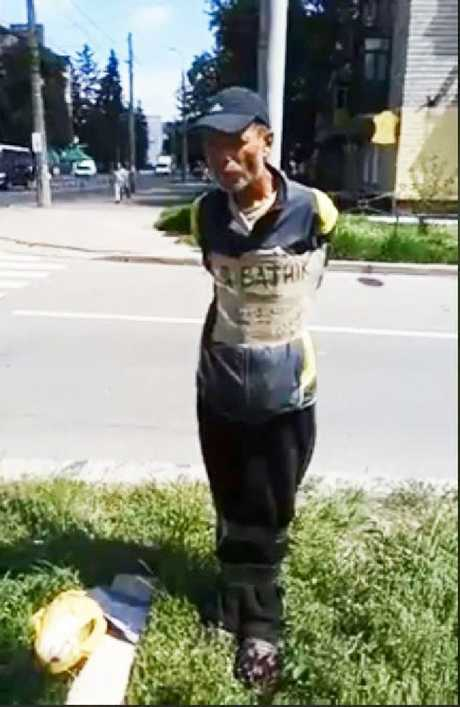 The man was tied to the street pole by residents after he damaged a war memorial in a Ukrainian town.