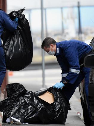 Police sift through rubbish for evidence in Anthony Street. Picture: Nicole Garmston.