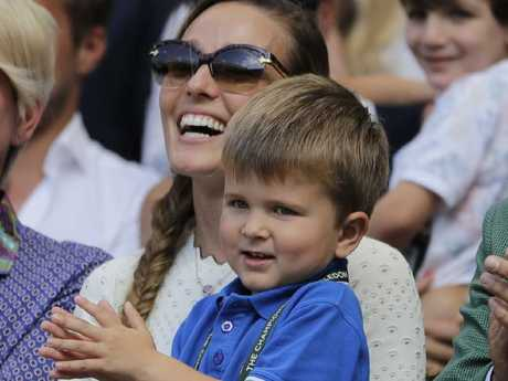 Jelena Djokovic and their son applaud after the men's singles final at Wimbledon.