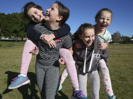 Allie Hamilton, 8, Rosie Blatch, 11, Taylor Hamilton, 11, and Darcy Ward, 7, playing in Queens Park, Sydney. Picture: Justin Lloyd.