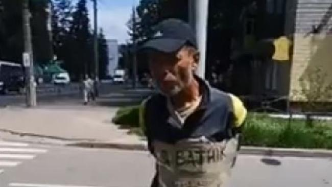 The man was tied to a pole in the Ukraine because he damaged a war memorial.