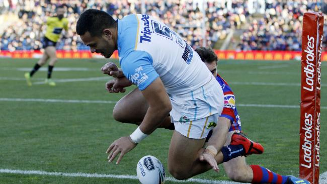 Phillip Sami of the Titans scores a second-half try against the Newcastle Knights on Saturday. Picture: Darren Pateman/AAP