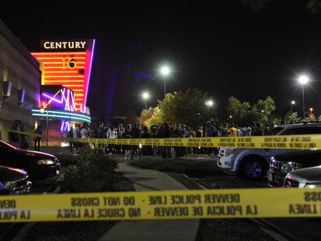 People gather outside the Century 16 cinema in Aurora, Colorado, after the mass shooting on July 20, 2012. Picture: Karl Gehring