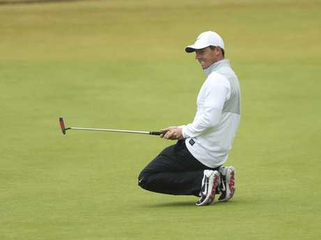 Rory McIlroy reacts after missing a birdie putt on the 18th green. Picture: AP