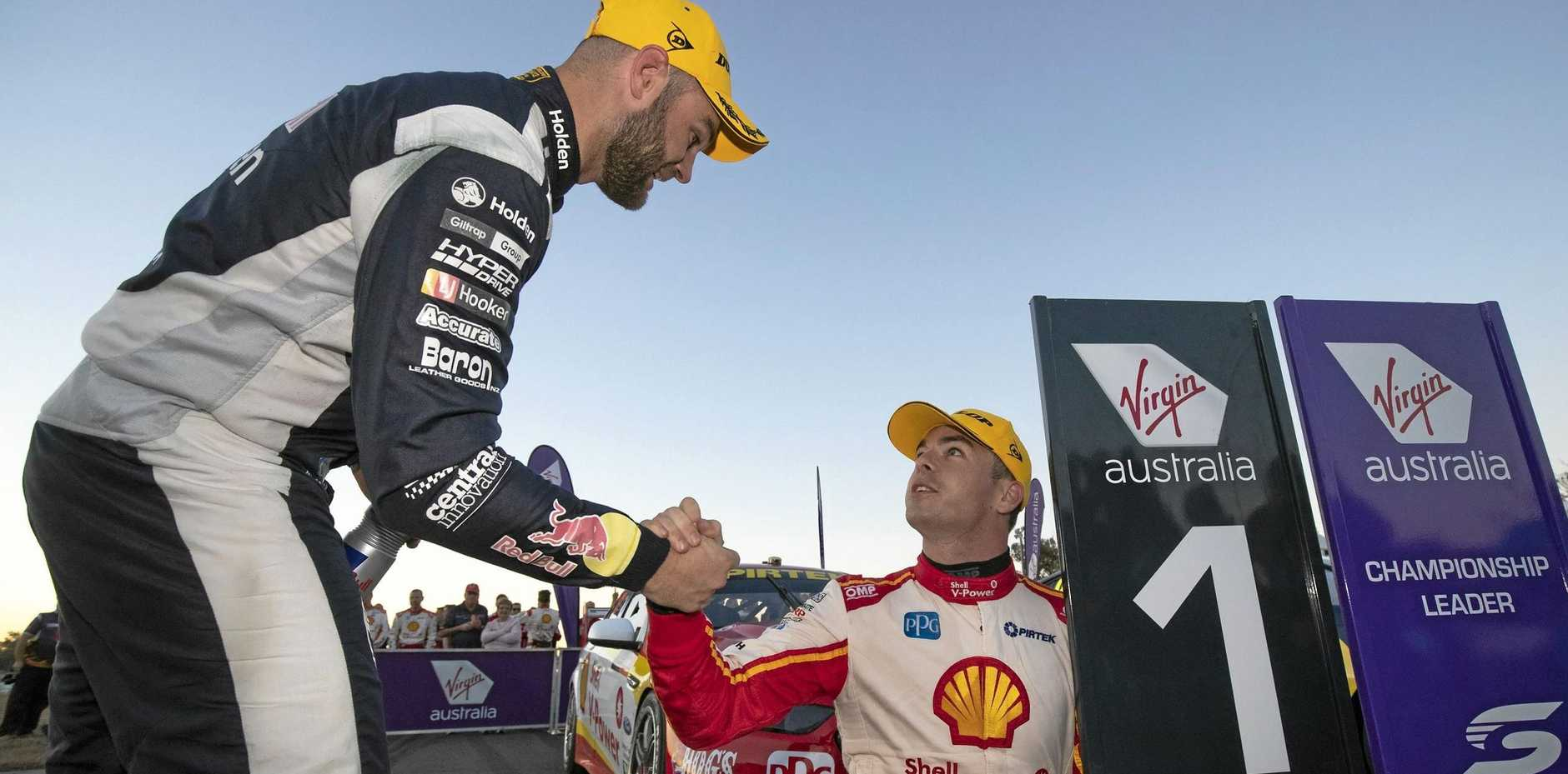 Shane van Gisbergen congratulates championship leader Scott McLaughlin after he won Saturday's race 19, the first in the latest Ipswich SuperSprint series at Queensland Raceway.