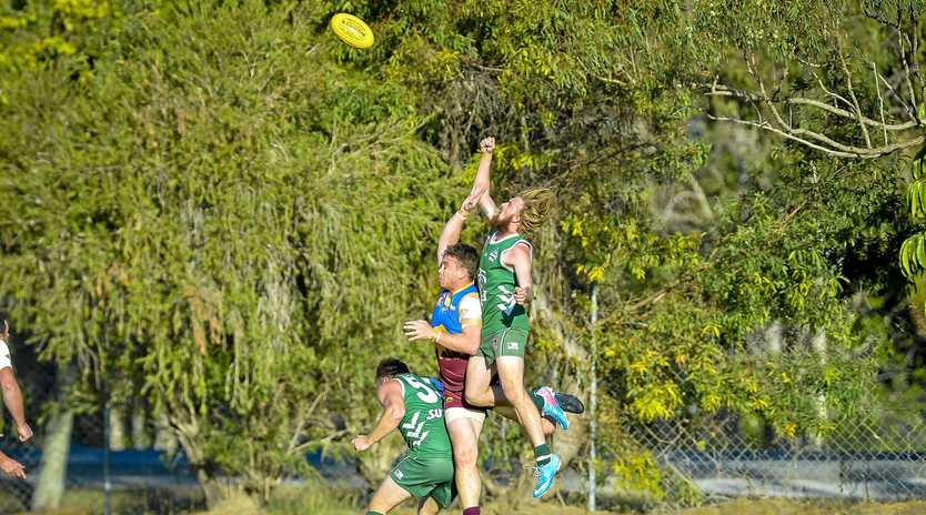 Gladstone Mudcrabs' Jay Warry and Glenmore's Toby Payne rise high for the ball over Gladstone's Ricky McClure.