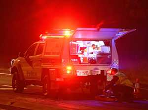 Car overturns into Bruce Highway ditch