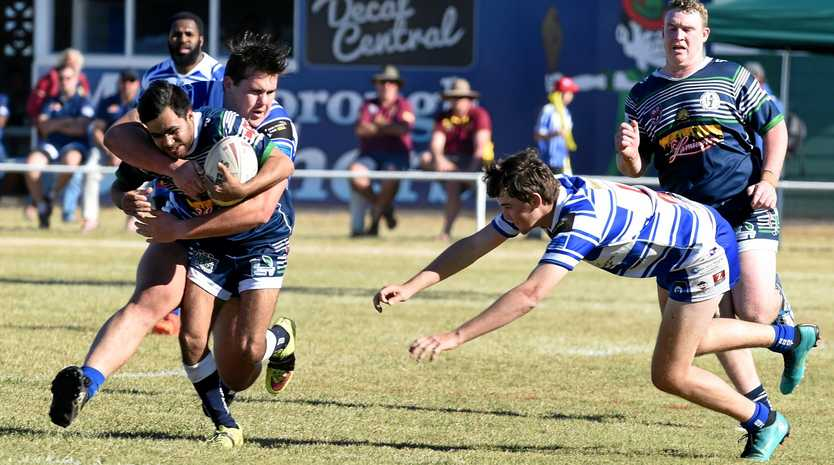 CHASE: Maryborough Brothers winger Jordan Dakin-Mimi is nabbed by the chasing Past Brothers defenders during the Bundaberg Rugby League game at Eskdale Park, Maryborough.