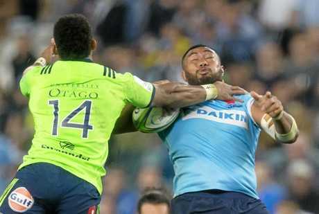 Sekope Kepu is hit hard by Highlanders rival Waisake Naholo.